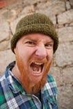 Portrait d'un type de hippie mettant le visage idiot Image libre de droits