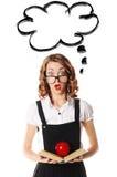 Portrait d'une écolière étonnée en verres sur un backgr blanc Photo stock
