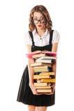 Portrait d'une écolière sur des verres sur un fond blanc avec Photographie stock libre de droits