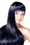 Portrait d'une belle jeune femme avec de longs cheveux brillants élégants Images libres de droits