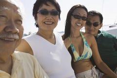 Portrait d'une famille dans le bateau Image libre de droits