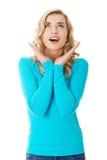 Portrait d'une femme étonnée avec la bouche ouverte Photographie stock libre de droits