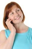 Portrait d'une femme d'une cinquantaine d'années assez rousse qui parle Photo stock