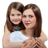 Portrait d'une femme et d'une fille Une famille heureuse Mère et enfant Photos stock