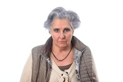 Portrait d'une femme supérieure sur le fond blanc image libre de droits