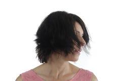 Portrait d'une femme sur le blanc image libre de droits