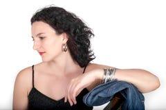 Portrait d'une jeune femme regardant à son côté Image libre de droits