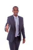 Portrait d'une jeune salutation d'homme d'affaires d'Afro-américain avec Photographie stock