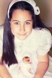 Portrait d'une petite fille dans son premier jour de communion Photos stock