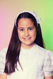 Portrait d'une petite fille dans son premier jour de communion Photographie stock libre de droits