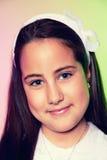 Portrait d'une petite fille dans son premier jour de communion Image stock