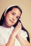 Portrait d'une petite fille dans son premier jour de communion Images stock