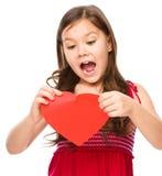 Portrait d'une petite fille triste en rouge Image libre de droits