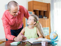 Portrait of dad helping schoolgirl to study Royalty Free Stock Photo
