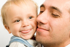 Portrait of dad and son. At the hands Royalty Free Stock Image