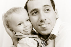 Portrait of dad and son. At the hands Stock Image