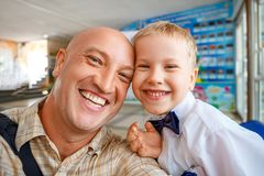 Portrait of dad and son happy hugging stock images