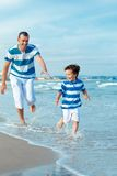 Portrait of dad and son at sea Stock Photo