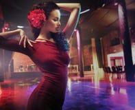 Portrait of a dancing brunette woman Stock Photo
