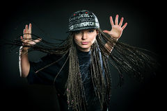 Portrait of dancing girl with dreadlocks in cap. Music and dance concept Stock Images