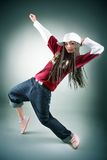 Portrait of dancing girl with dreadlocks in cap. Music and dance concept Stock Photo