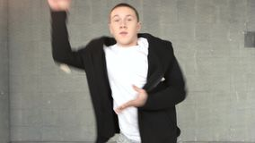 Portrait of dancing teen boy. Trendy teen guy performing contemporary dance moves. Art of street dance stock video