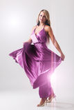 Portrait of a dancing woman with dress in motion. Portrait of a dancing woman with purple dress in motion Stock Photos