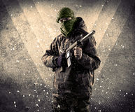 Portrait of a dangerous masked armed soldier with grungy backgro Stock Photo