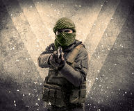 Portrait of a dangerous masked armed soldier with grungy backgro Royalty Free Stock Photos