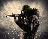 Portrait of a dangerous masked armed soldier with grungy backgro Stock Images