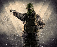 Portrait of a dangerous masked armed soldier with grungy backgro Stock Photos