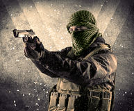 Portrait of a dangerous masked armed soldier with grungy backgro Stock Image