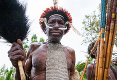 Portrait of Dani tribe in a beautiful headdress made of feathers. Stock Image
