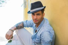 Handsome young man with black hat Royalty Free Stock Images