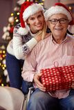 Portrait of daughter and elderly father in wheelchair celebratin Stock Photography