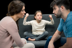 Portrait of daughter and upset parents on black Royalty Free Stock Photos