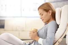 Portrait of daydreaming woman with tea cup Royalty Free Stock Photography