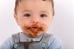 Portrait de bébé après avoir mangé du chocolat Image libre de droits