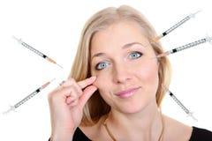Portrait de beauté de chirurgie plastique d'une femme avec des injecteurs Photo stock