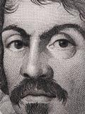 Portrait de Caravaggio sur 100000 Lires italiennes de macro de billet de banque Un o Image stock