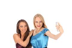 Portrait de deux belles filles faisant des selfies Photo libre de droits