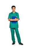 Portrait de docteur avec le dossier santé sur le fond blanc Photo stock