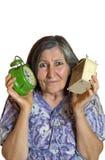 Portrait de femme choquée avec le réveil deux. image stock