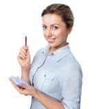 Portrait de femme d'affaires avec un bloc-notes Images libres de droits