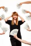 Portrait de femme d'affaires réussie parmi l'argent au-dessus du fond blanc Photographie stock libre de droits