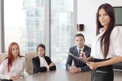 Portrait de femme et d'équipe d'affaires Images stock