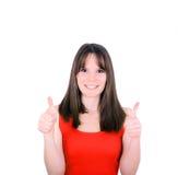 Portrait de femme heureuse avec des pouces sur le fond blanc Photographie stock libre de droits