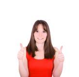 Portrait de femme heureuse avec des pouces sur le fond blanc Photo stock