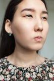 Portrait de fille asiatique fâchée Photos stock