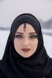 Portrait de fille avec haut étroit d'yeux bleus Photographie stock